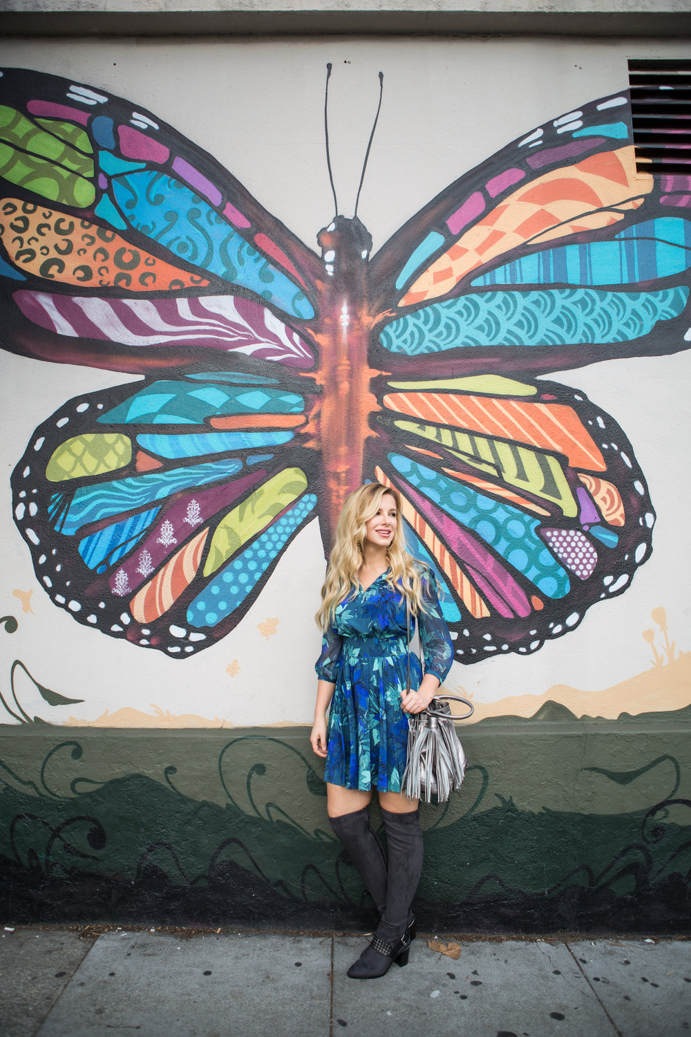 Blonde in front of Butterfly art