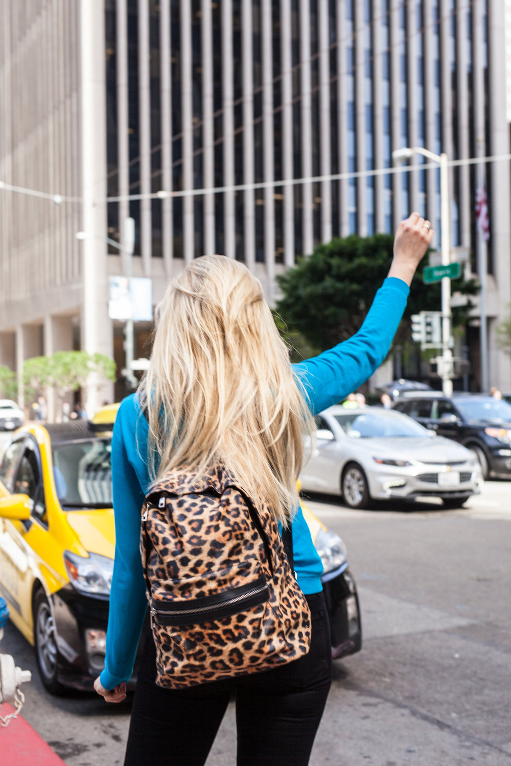 Blonde Wearing Leopard Print Backpack