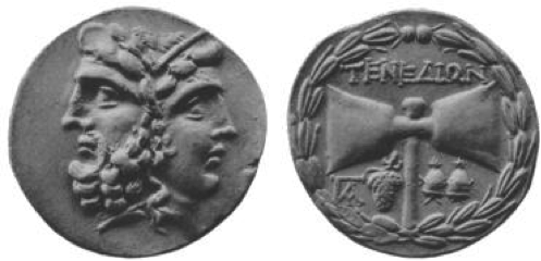 Coin from Island of Tenedos, after circ. B.C. 189. Janiform head, double axe with bunch of grapes