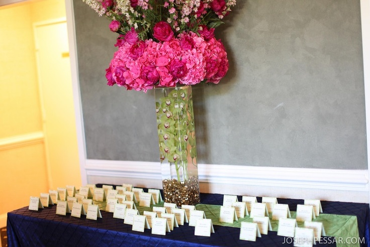 Card Table Piece, at the entrance to the ballroom the guests were greeted with an oversize topiary in hot pinks and greens, I like doing an exaggerated card table piece because I feel it really sets the tone for the even before the guests walk into the reception room.