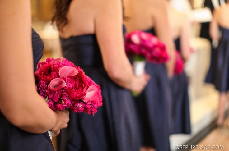 Bridesmaids carried bouquets of mixed flowers in hot pink tones including callas, stock flower and peonies.