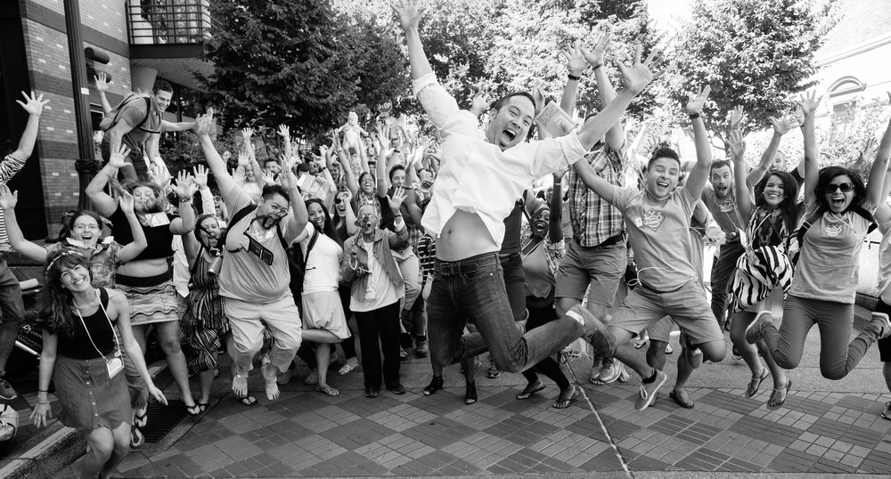 This photo exemplifies how I feel about attending World Domination Summit in Portland, Oregon. It features the WDS Concierge Jedd Chang jumping for joy with friends. Photo credit: Armosa Studios