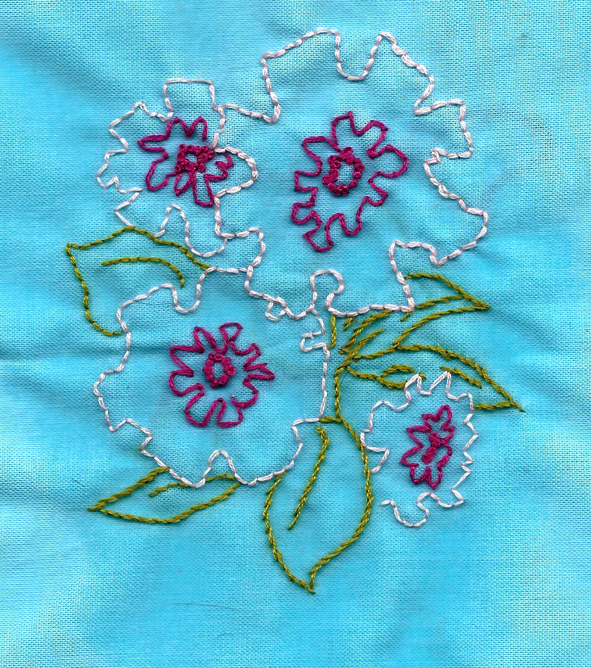 peach and magenta imaginary flowers. art by my gram. embroidery by me.