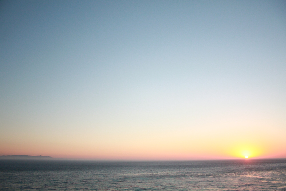 the ocean and the sky at sunset