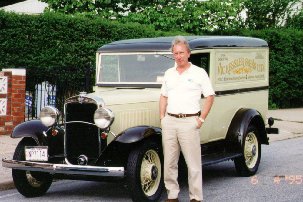 Vic, standing beside his 1932 Chevy panel truck