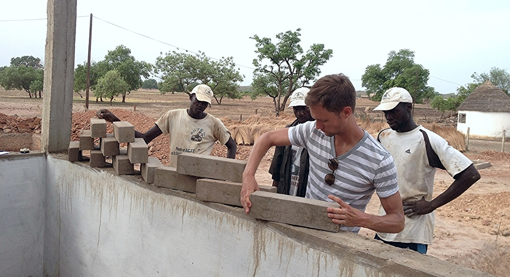 The project architect discusses the brick pattern with local masons.