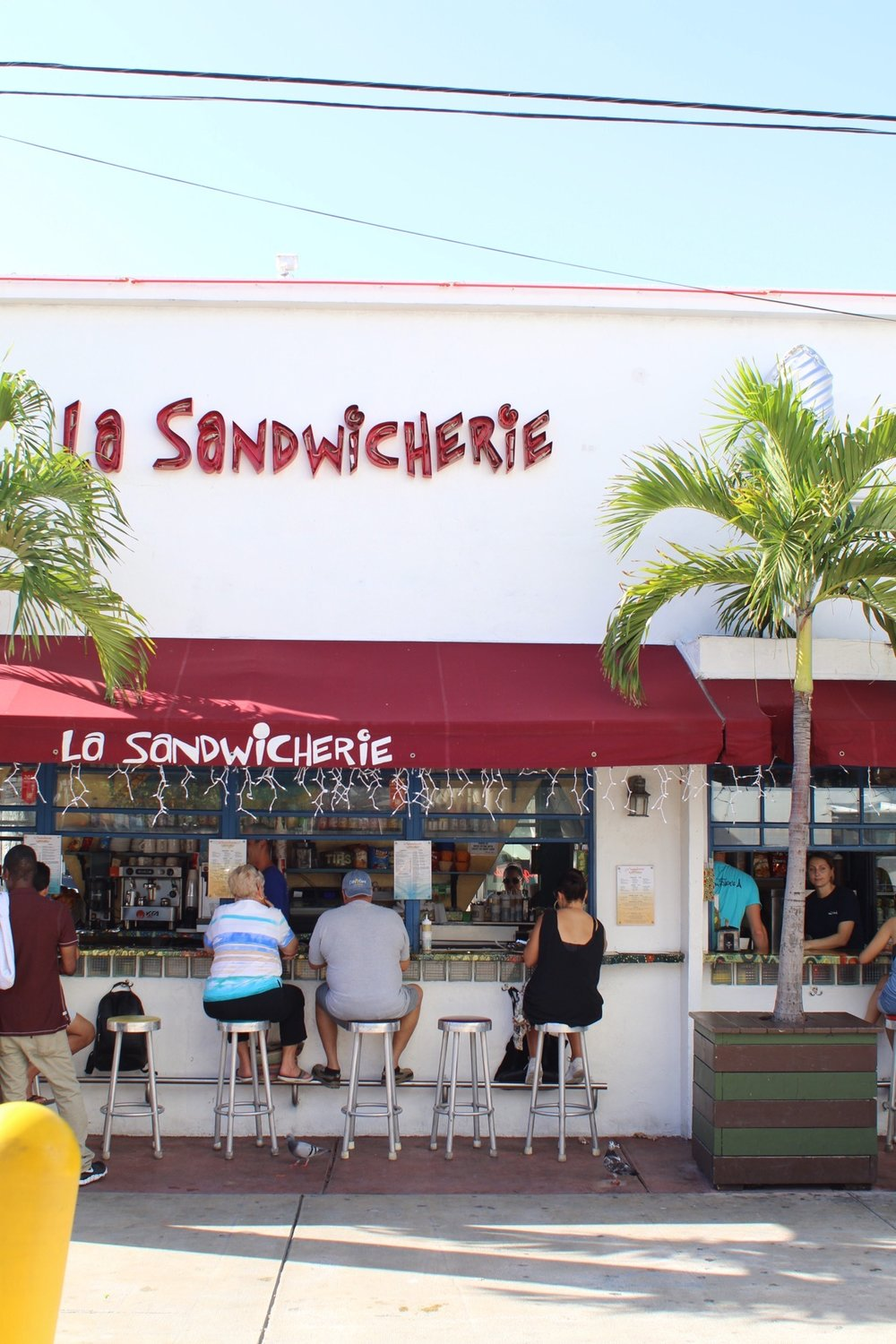 Tropical vibes and questionable font choice at La Sandwicherie