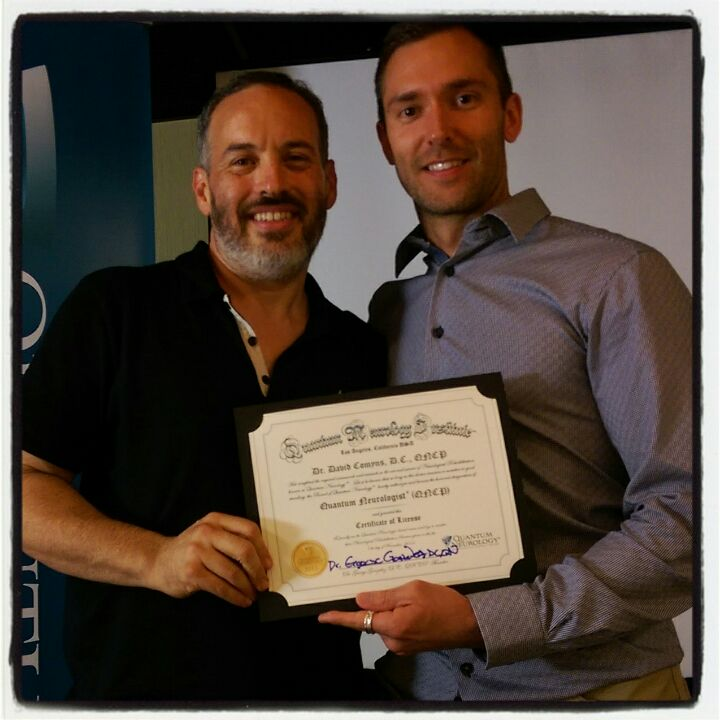 Dr David Comyns receiving his qualification from the founder of Quantum Neurology, Dr George Gonzalez