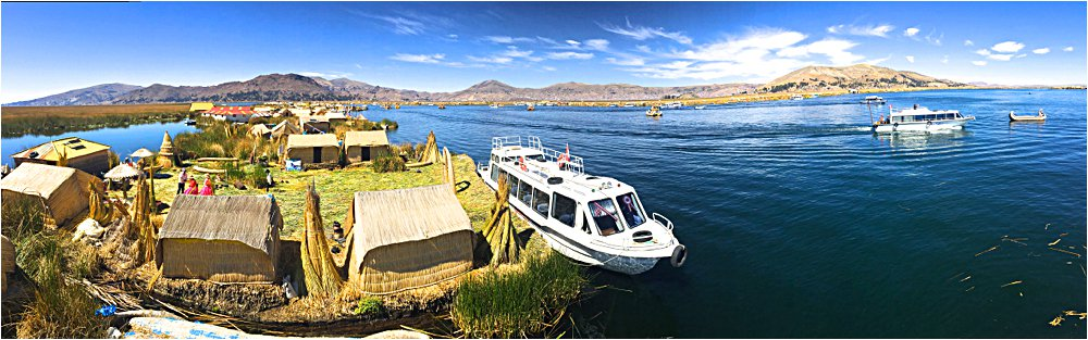A pano from the top of a very shaky reed tower showing the floating islands (and the tour boat!).