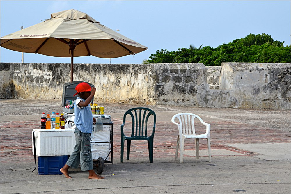 This kid was selling beers in the old city in Cartagena.