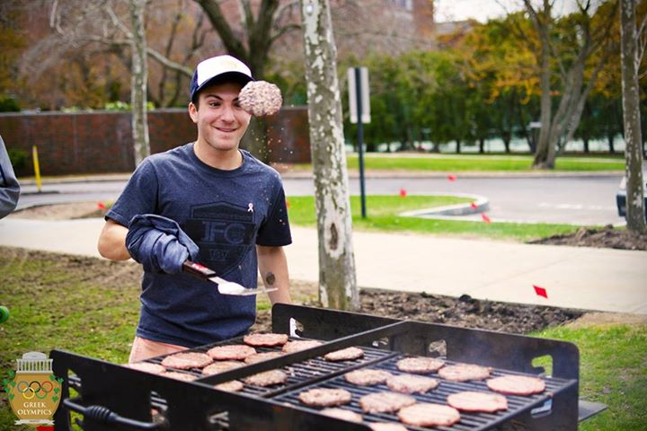 IFC VP 2014, Sam Oppenheim, grilling burgers for hungry Greek Olympics attendees.