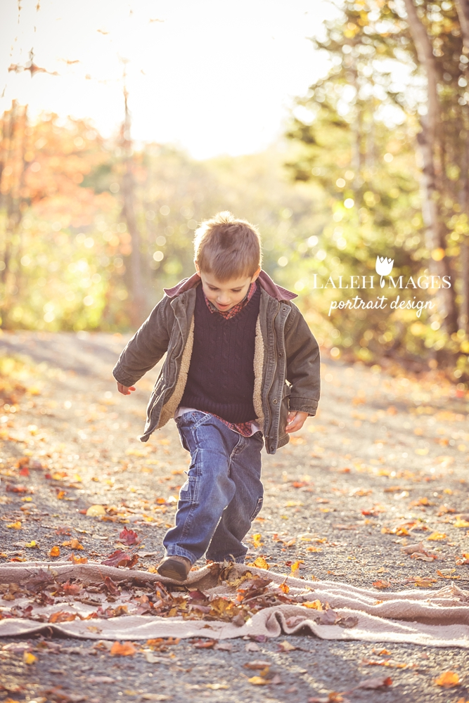 Child photography jumping in leaves