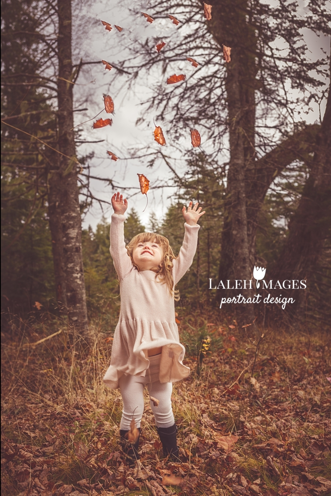 Toddler throwing leaves picture