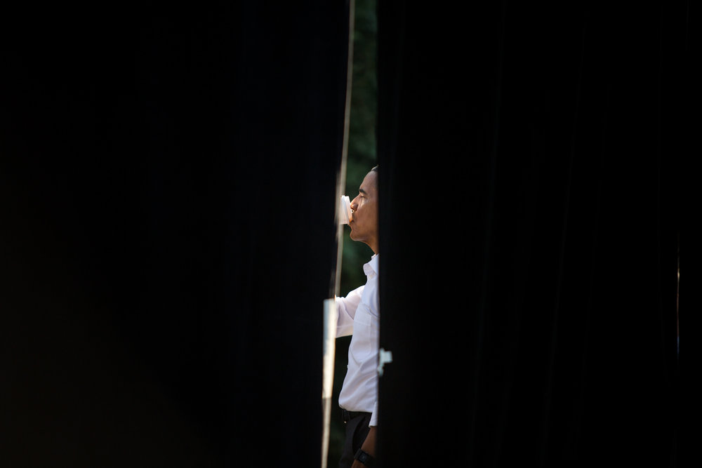 President Barack Obama finishes his coffee moments before addressing students at The University of North Carolina at Chapel Hill while on the campaign trail for Hillary Clinton.