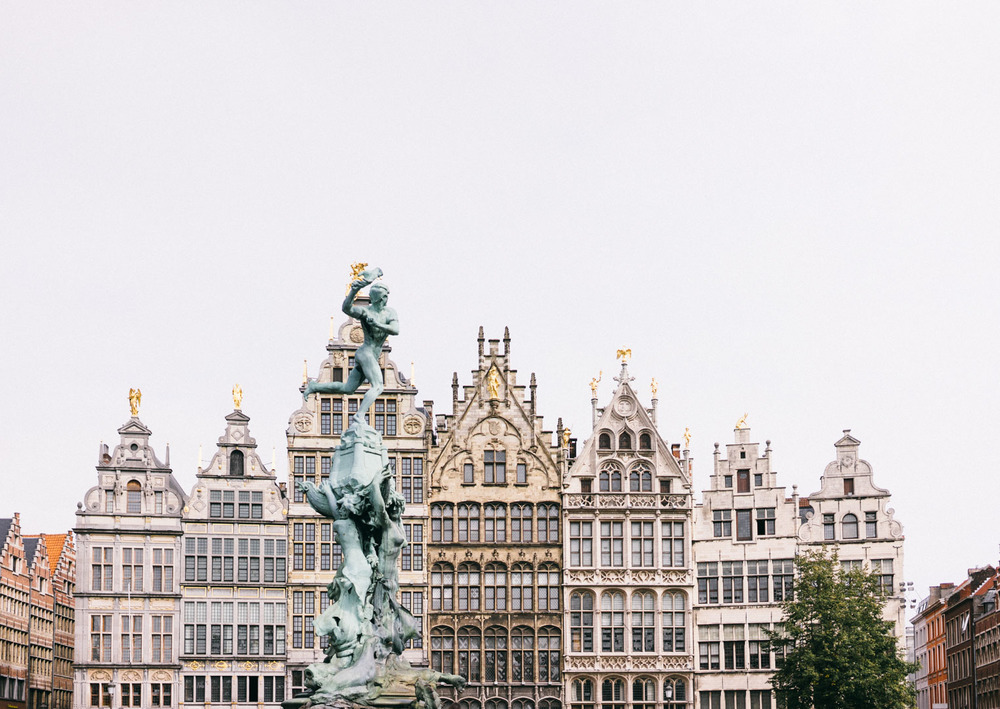 Grote Markt, the town square of Antwerp, is surrounded by guildhalls dated back to medieval. This is the most stunning scene during our Belgium trip. The strong visual through-back.