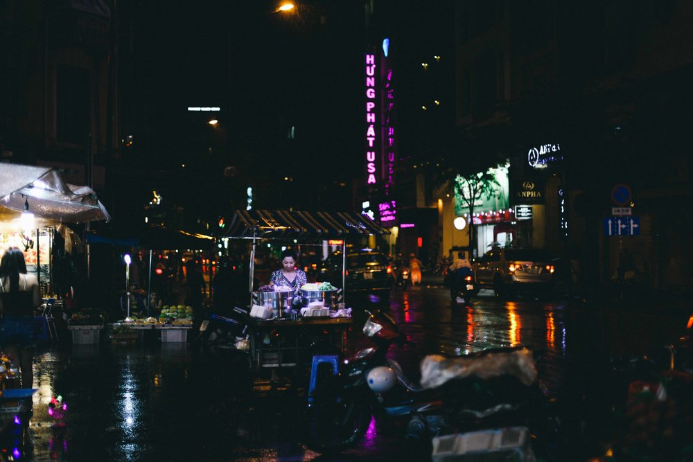 le sycomore ho chi minh night scene food stand