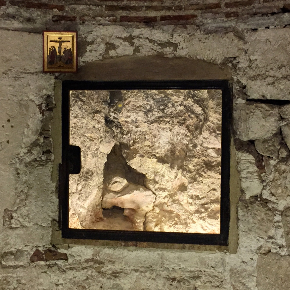 The rock of Calvary, viewed through a window in the Chapel of Adam. Allegedly cracked by an earthquake when Jesus was crucified.