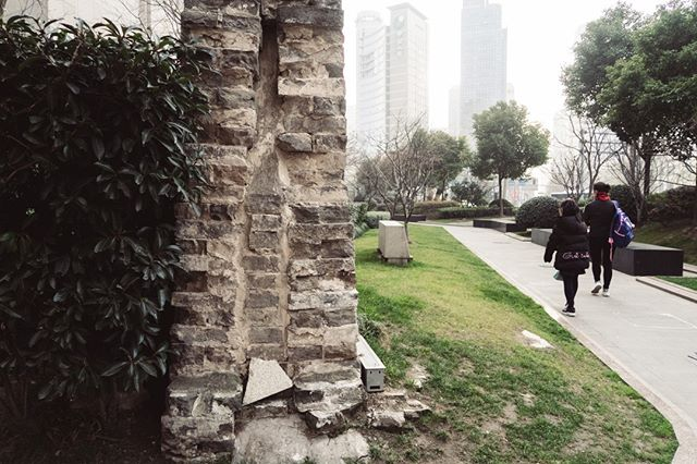 Old Shanghai Wall is a remnant of the wall that used to surround old Shanghai. It currently sits amongst multi-level residential buildings surrounded by trees, foot traffic, and retail shops just a few steps away from a busy street. • • Shanghai, China • • #beautifuldestinations #stayandwander #artofvisuals #adventureseeker #travelbloggers #travelblogging #tblogger #travellifestyle #seekmoments #goexplore #travelmore #wonderfulplaces #travelwithme #photooftheday #travelphotography #phooftheday #shanghai #oldshanghai #chinesehistory  #china #instachina