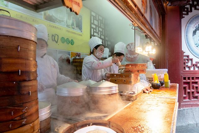 A busy dumpling shop in the retail area near Shanghai's Yu Garden. Buy a ticket, line up and give your ticket for either several soup dumplings or 1 large soup dumpling. Fast, delicious, and fun to eat! • • Shanghai, China • • #beautifuldestinations #stayandwander #artofvisuals #adventureseeker #travelbloggers #travelblogging #tblogger #travellifestyle #seekmoments #goexplore #travelmore #wonderfulplaces #travelwithme #photooftheday #travelphotography #phooftheday #dumplings #soupdumplings #streetfood #streetphotography #shanghai #china #yugarden #foodstand #foodstagram #restaurantdecor #restaurantdesign