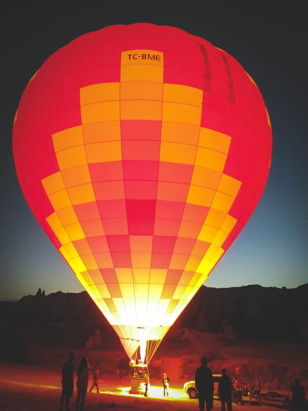 HEAT FROM THE BURNER EXPANDS THE AIR INSIDE THIS HOT AIR BALLOON