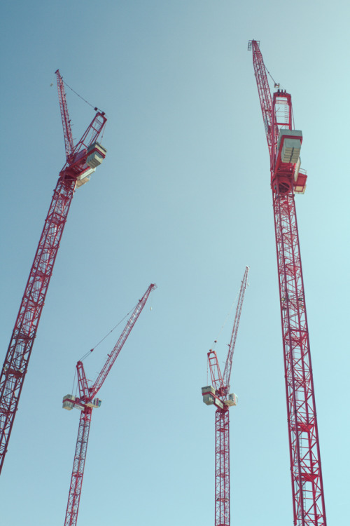 CRANES HAVE A COUNTER WEIGHT ON THEIR BACKSIDE TO BALANCE THE FORCES OF GRAVITY