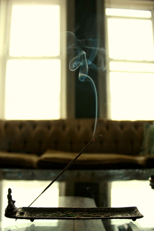 A TRAIL OF SMOKE RISES FROM THE INCENSE BURNING