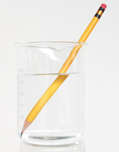 WATER REFRACTS THE SHAPR OF THIS PENCIL