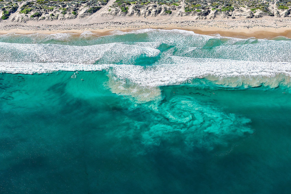 A AERIAL SHOT OF A RIP CURRENT