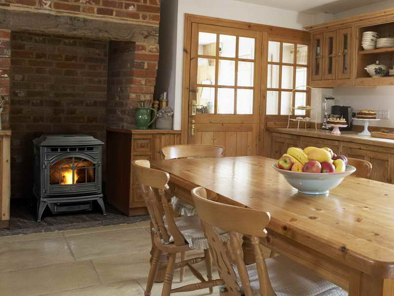 This pellet wood burner looks perfect in this traditional cozy kitchen