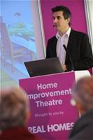 Michael-Holmes-talking-to-the-audience at the Homebuilding and Renovating Sho