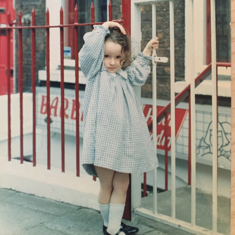 At the age of about 4 in Limerick City, Ireland. I did love posing!