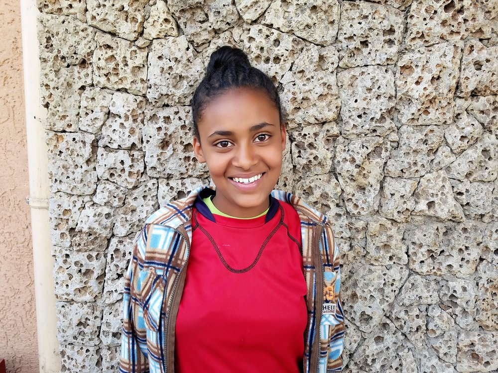 This is Tizita, who I'm currently supporting.  - She lives in Ethiopia and has access to quality education, a safe place to live and study, access to healthcare, clothing and anything else she needs to thrive.
