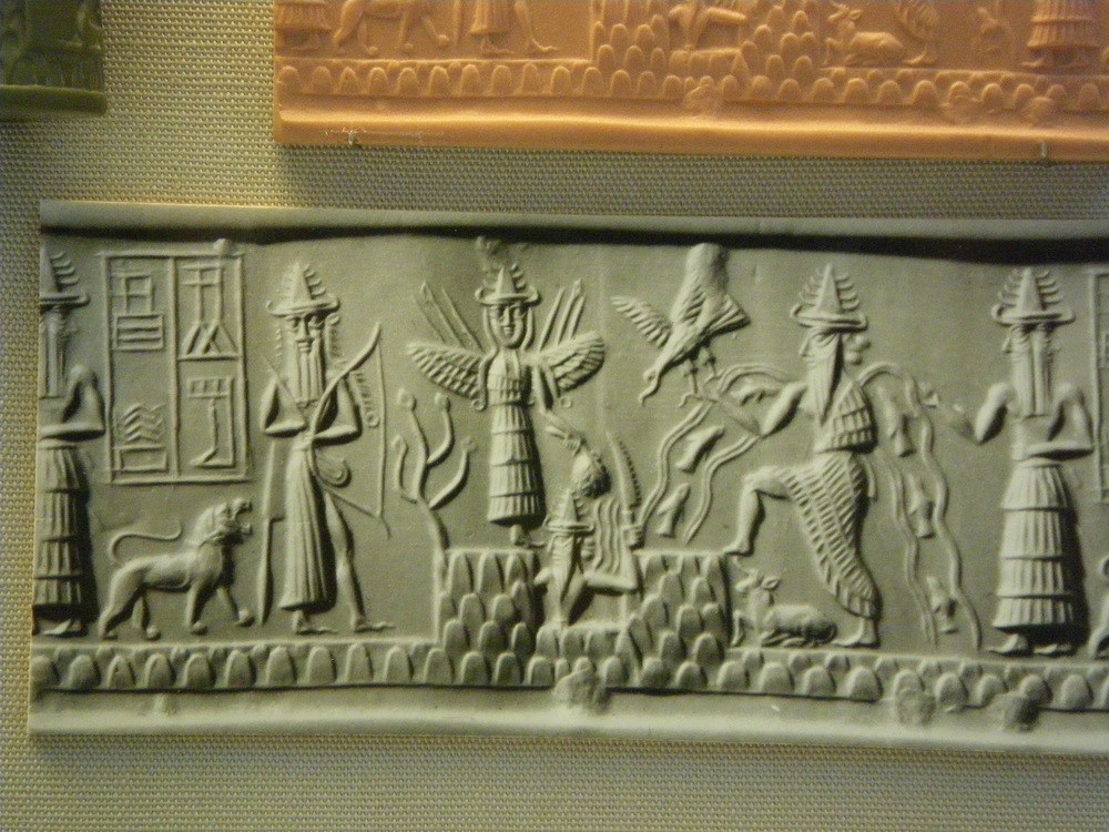 Figure 3.4. A magnified image of a pressing from a cylinder seal from the Sargonid (Akkadian) period, third millennium BCE, commemorating the return to fertility in the new year. The sun god Shamash can be seen arising out of the mound in the center, is greeted by Inanna as a vegetation goddess, her shoulders sprouting rays of vegetation. On the plain is a hunter with his lion. To the right is the god Enki (the Akkadian god Ea) with a Janus-headed attendant; he restrains the storm bird Zu, the adversary who stole the Tablets of Destiny; the animal at his feet is a ram (note the horn). British Museum.