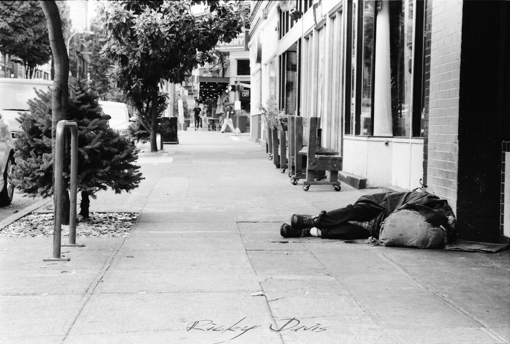 Homeless girl sleeping on the sidewalk - Portland, OR - Photographer Ricky Davis of TRD Photography - Ilford 400 HP5 Film
