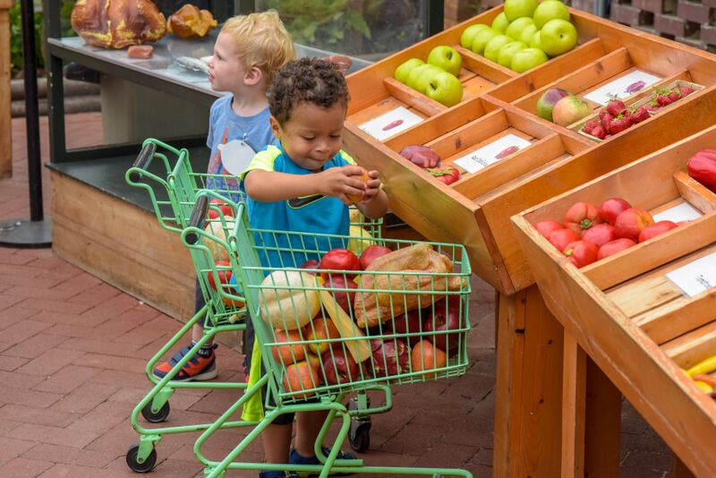 Playtime in the Farmer's Market. Photo by Paul g. Wiegman.