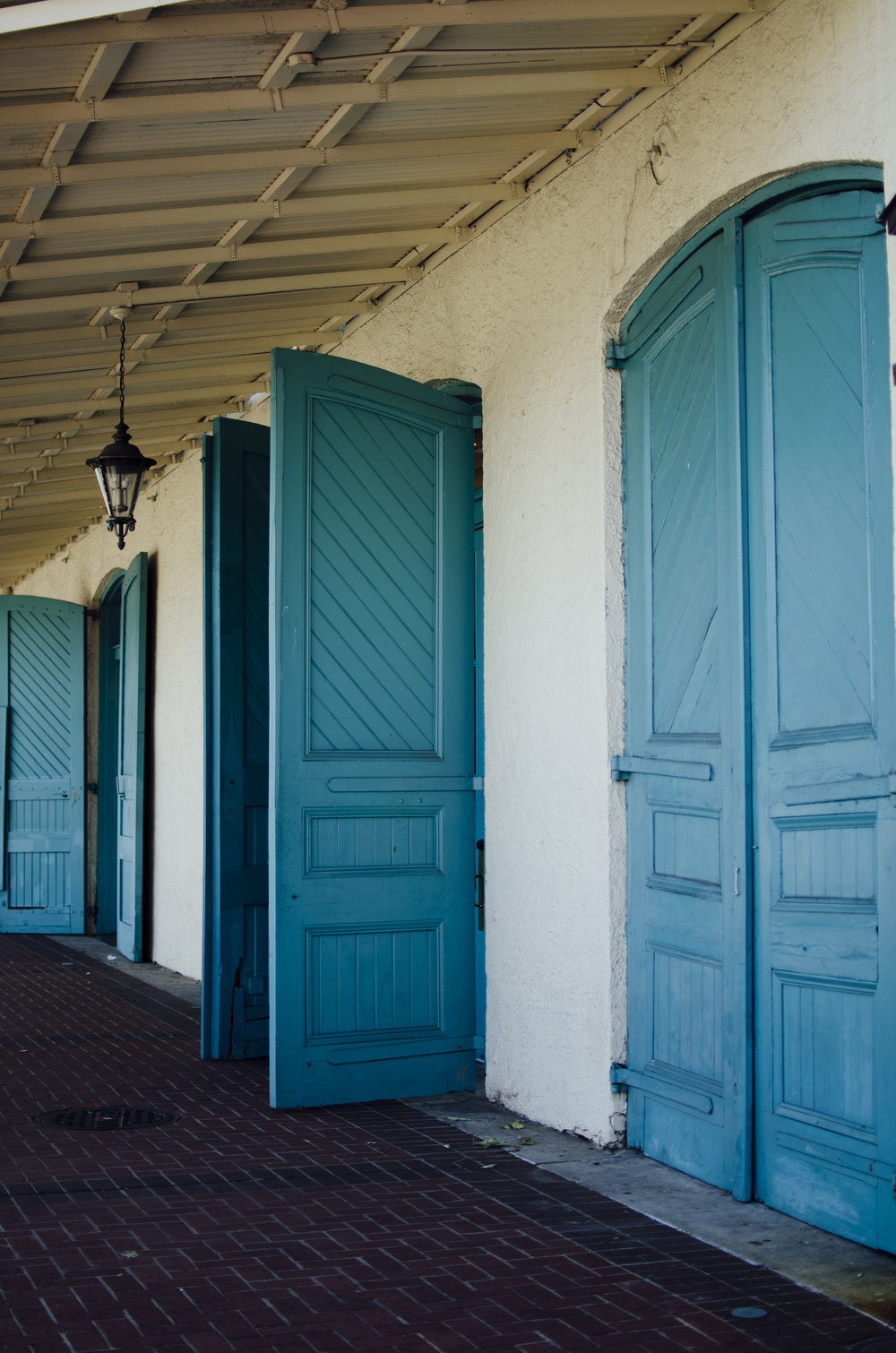 "Some more ""statement"" doors. These beautiful torquoise doors those of Mulate's the Original Cajun Restaurant off Julia St in Downtown New Orleans"