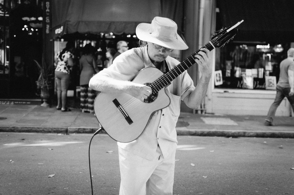 This cool man was playing right outside of Cafe Beignet and so many people were sitting on the sidewalk watching and hearing him play some tunes by The Beatles. My dad is a music lover so he lit up a cigar(he was feeling fancy) and stood by listening to the musician play.