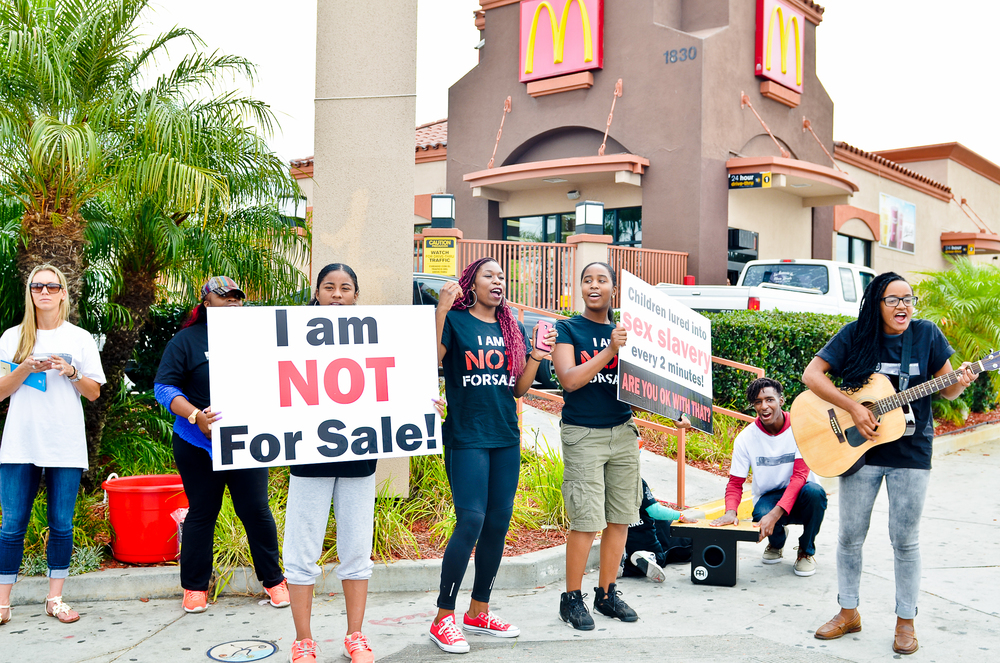 """Chants like, """"I don't want to be for sale 'cuz it's not ok!"""" were sung at the rally on Saturday."""