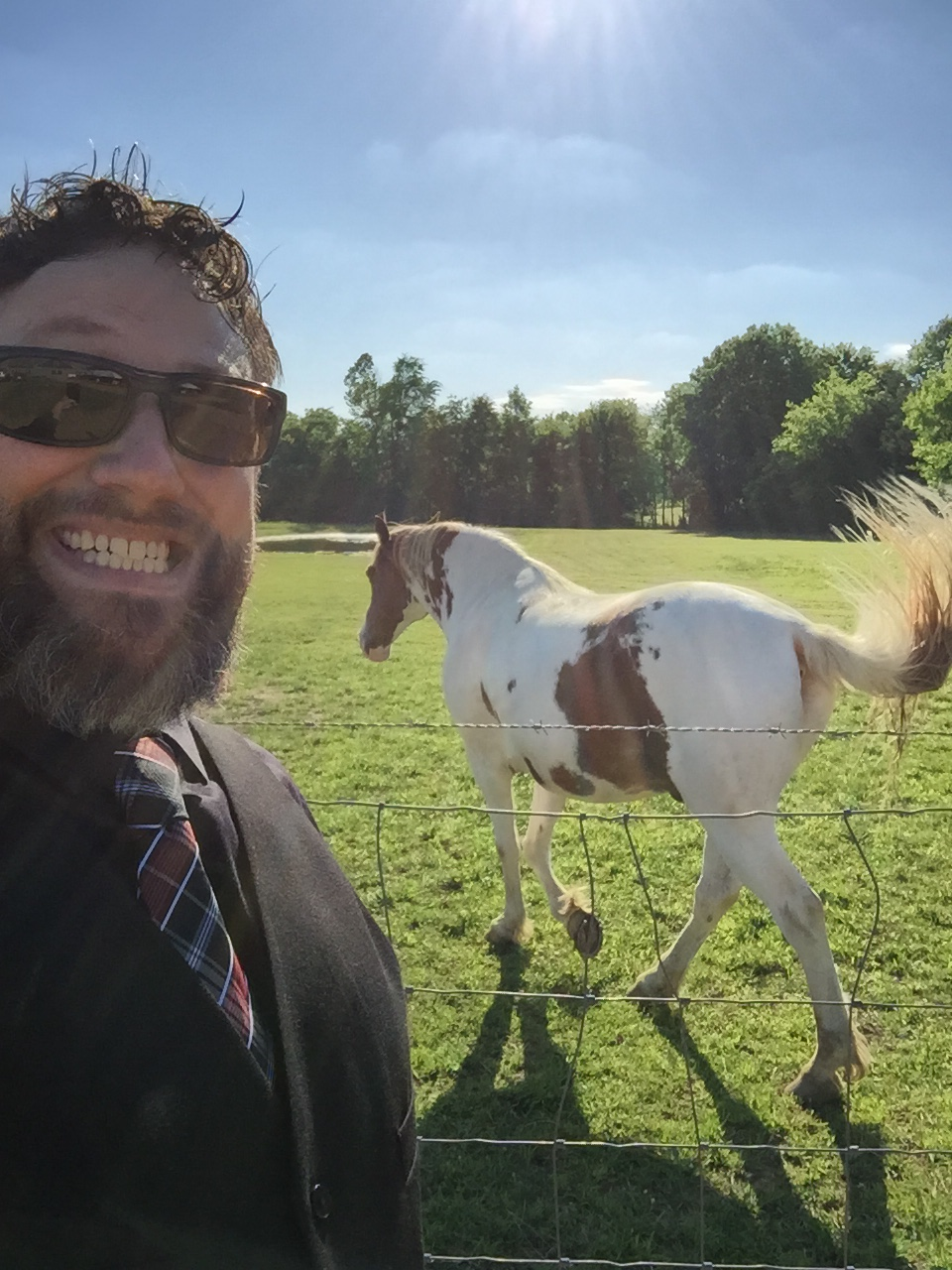 Brad Ford hanging out with Emily's uncle's horses.