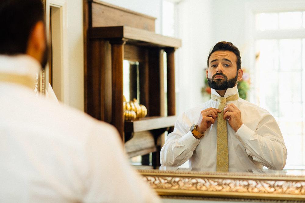 groom-tying-tie.jpeg