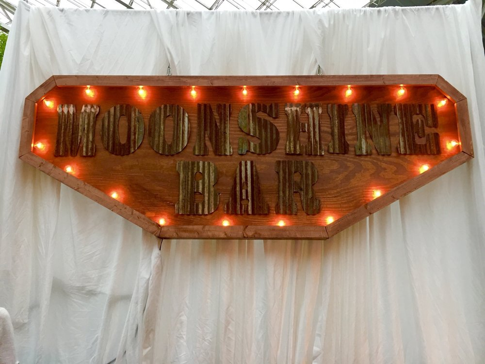 Our custom crafted Moonshine Bar sign is available for your upcoming event!