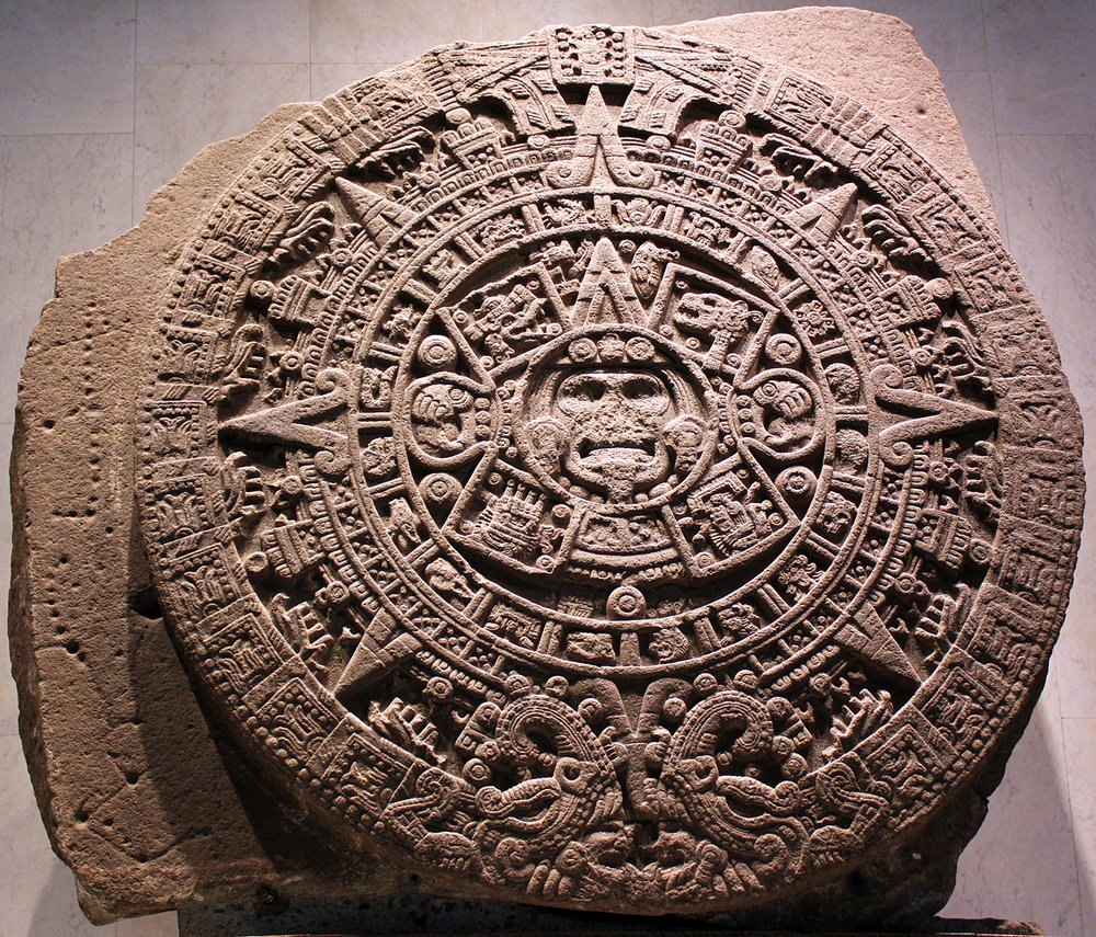 1280px-1479_Stein_der_fünften_Sonne,_sog._Aztekenkalender,_Ollin_Tonatiuh_anagoria.JPG