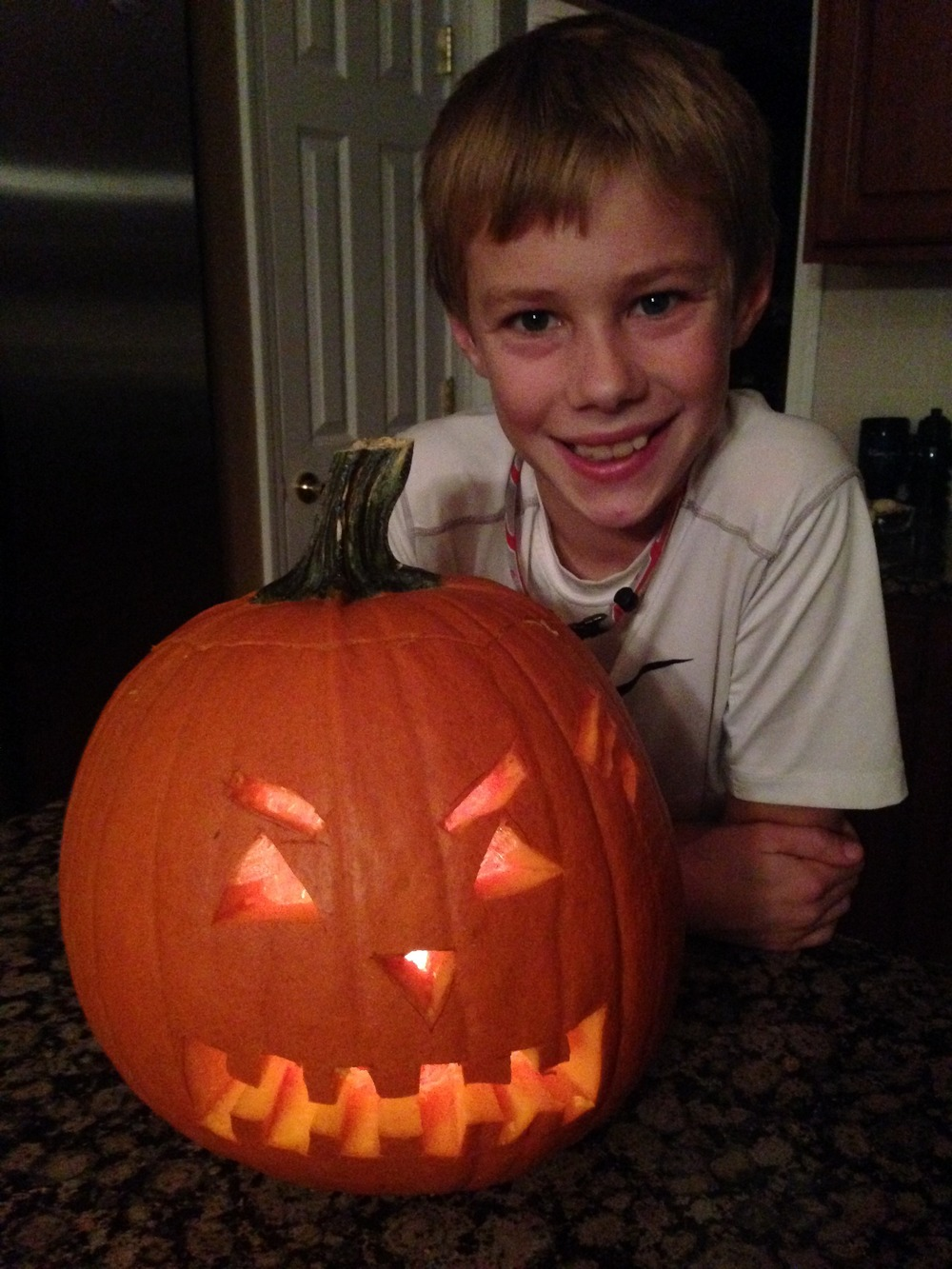 Proud boy carved it all by himself with a little help from mom.