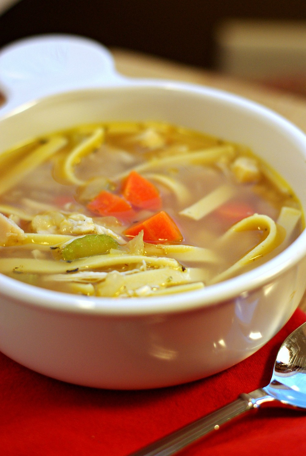 Classic, homemade chicken noodle soup with tender bits of chicken ...