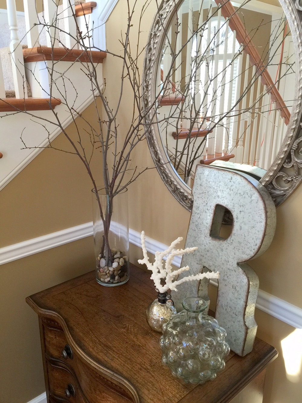 Decorate your home using tree branches from your backyard.