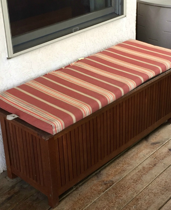 Screened Porch Decorating Ideas | Home & Plate | www.homeandplate.com | A wooden storage bench doubles as seating when needed.