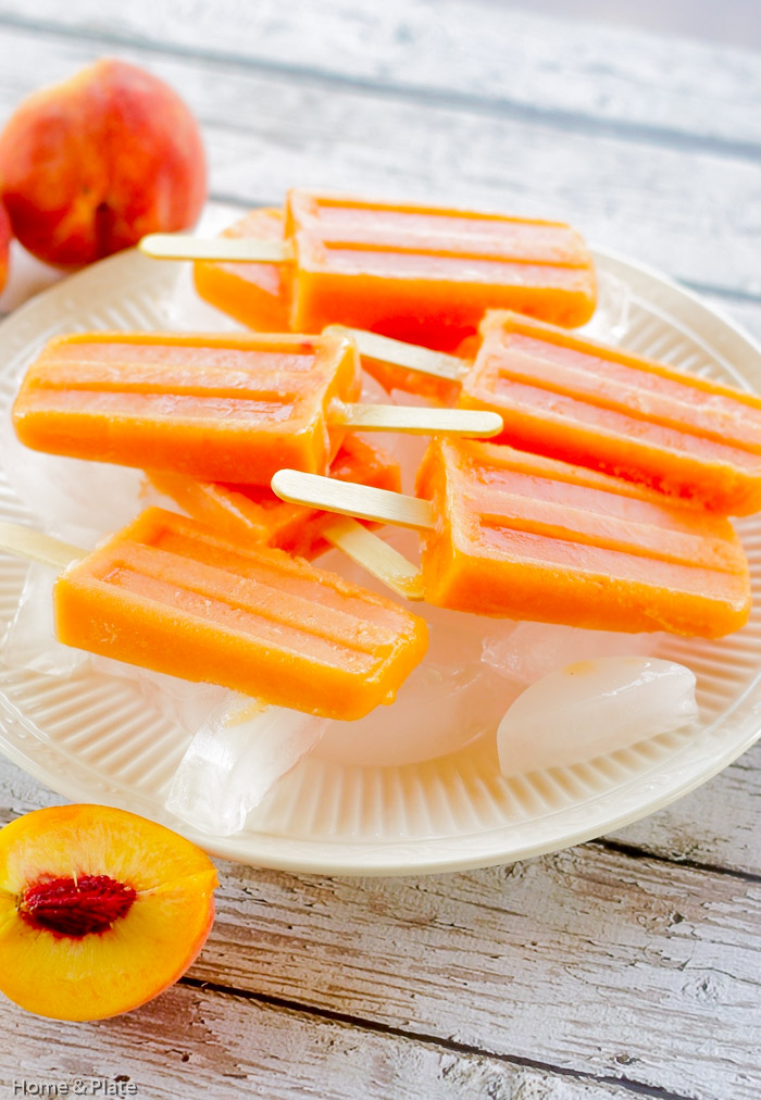 Peach Ginger Ice Pops | Home & Plate | www.homeandplate.com | These ice pops promise that same summertime nostalgic feeling of biting into this sweet stone fruit.