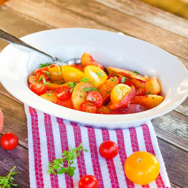 Peach, Tomato & Basil Salad | Home & Plate | www.homeandplate.com | Fresh, juicy ripe peaches. Sweet red and yellow tomatoes picked fresh from the vine and fragrant basil. Isn't this what summer is all about.