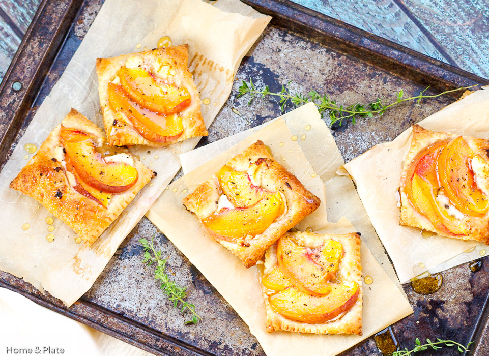 Peach Tarts with Goat Cheese & Honey | Home & Plate | www.homeandplate.com | The peaches caramelize beautifully and pair deliciously with the warm goat cheese.