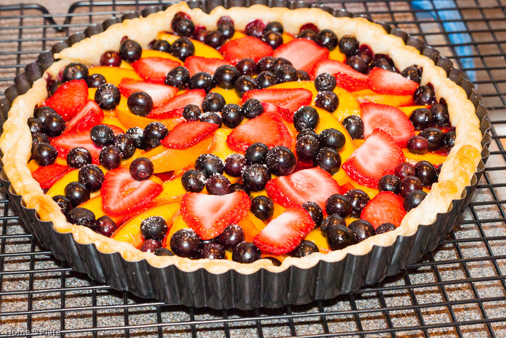 Classic Peach Tart with Summer Berries | Home & Plate | www.homeandplate.com | This easy summer fruit tart is the perfect dessert for any dinner party. Peaches, strawberries and blueberries are the stars of this show.